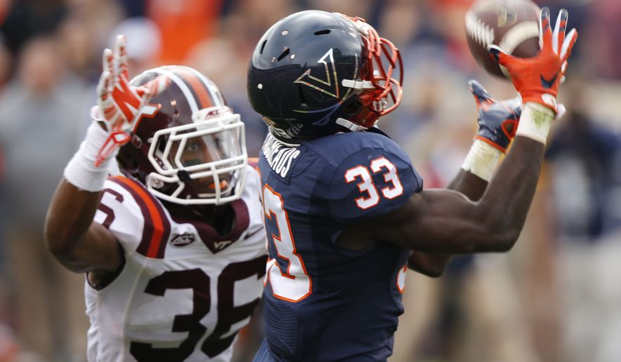 FILE - This Saturday Nov. 28, 2015, file photo shows Virginia running back Olamide Zaccheaus (33) as he hauls in a pass as Virginia Tech Adonis Alexander (36) defends in Charlottesville, Va. Zaccheaus was expected to provide a huge spark on offense for Virginia last season, and while the diminutive speedster showed flashes of what might have been, a balky hamstring limited his opportunities. (AP Photo/Steve Helber, File)