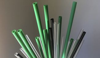 This May 23, 2018, file photo shows plastic drinking straws in New York. The European Union is proposing bans on plastic products like cotton buds, straws, stirs and balloon sticks when alternatives are easily available in an attempt to cut marine litter. (AP Photo/Barbara Woike, File)