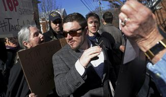 In this Feb. 27, 2018, file photo, Jason Kessler walks through a crowd of protesters in front of the Charlottesville Circuit Courthouse ahead of a decision regarding the covered Confederate statues, during a rally in Charlottesville, Va. (Zack Wajsgras/The Daily Progress via AP, File)