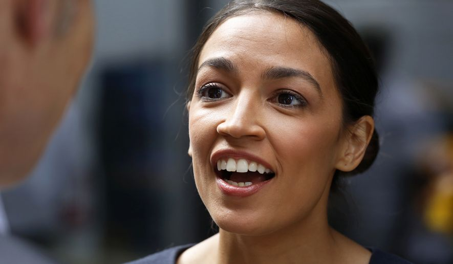 In this June 27, 2018 file photo, Democrat Alexandria Ocasio-Cortez  speaks to the media in New York, the day after her congressional primary upset over 10-term incumbent Joe Crowley. Ocasio-Cortez is now criticizing him for not getting his name off the ballot in the general election. Despite his loss in New York's Democratic primary, Crowley's name will still be on the ballot as the candidate of the lesser-known Working Families Party in November. (AP Photo/Mark Lennihan, File)