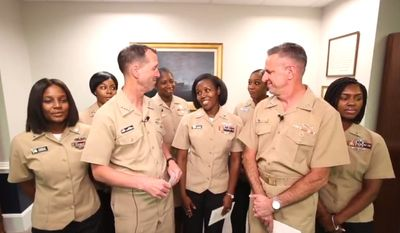Chief of Naval Operations Adm. John Richardson (left), and Chief of Naval Personnel Adm. Robert Burke reveal new grooming standards for women in the U.S. Navy, July 10, 2018. (Image: Facebook, U.S. Navy, CNO & CNP Facebook Live All-Hands Call) ** FILE **