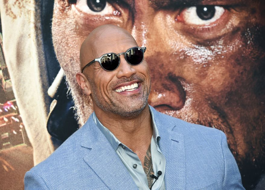 """FILE - In this July 10, 2018 file photo, Actor Dwayne Johnson attends the """"Skyscraper"""" premiere in New York. Johnson, who plays an amputee in the action movie, said Thursday, July 12, he is joining the Boston-based Ruderman Family Foundation, calling for more inclusion and opportunities for people with disabilities in the entertainment industry. (Photo by Evan Agostini/Invision/AP, File)"""