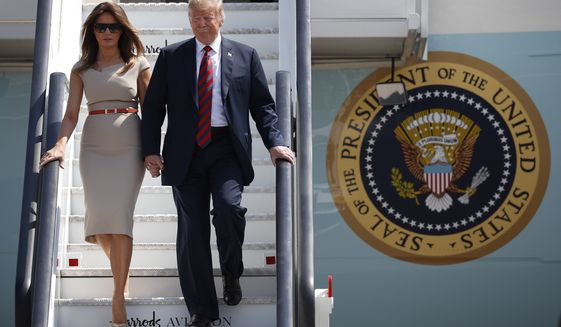 U.S. President Donald Trump and first lady Melania Trump step off Air Force One as they arrive at London's Stansted Airport, Thursday, July 12, 2018. (AP Photo/Pablo Martinez Monsivais)