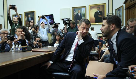 "FBI Deputy Assistant Director Peter Strzok talks to attorney Aitan Goelman as he waits for the start of a joint hearing on ""oversight of FBI and Department of Justice actions surrounding the 2016 election"" on Capitol Hill in Washington, Thursday, July 12, 2018. (AP Photo/Manuel Balce Ceneta)"