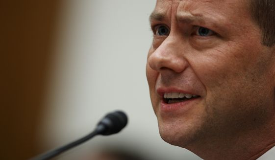 """FBI Deputy Assistant Director Peter Strzok testifies before the the House Committees on the Judiciary and Oversight and Government Reform during a hearing on """"Oversight of FBI and Department of Justice Actions Surrounding the 2016 Election,"""" on Capitol Hill, Thursday, July 12, 2018, in Washington. (AP Photo/Evan Vucci)"""