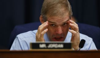"""Rep. Jim Jordan, R-Ohio, listens to FBI Deputy Assistant Director Peter Strzok testify before the House Committees on the Judiciary and Oversight and Government Reform during a hearing on """"Oversight of FBI and Department of Justice Actions Surrounding the 2016 Election,"""" on Capitol Hill, Thursday, July 12, 2018, in Washington. (AP Photo/Evan Vucci) **FILE**"""