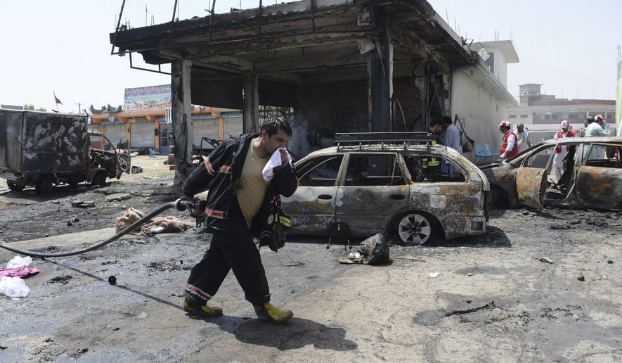 Firefighters work at the site of a deadly suicide attack in Jalalabad, the capital of Nangarhar province, Afghanistan, Tuesday, July 10, 2018. An Afghan official said at least 10 people, including two intelligence service agents and eight civilians, have been killed in the suicide attack in eastern Afghanistan. (AP Photo)
