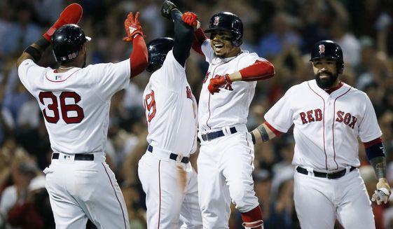 Boston Red Sox's Mookie Betts, center right, celebrates his grand slam that drove in Eduardo Nunez (36), Jackie Bradley Jr., center left, and Sandy Leon during the fourth inning of a baseball game against the Toronto Blue Jays in Boston, Thursday, July 12, 2018. (AP Photo/Michael Dwyer)