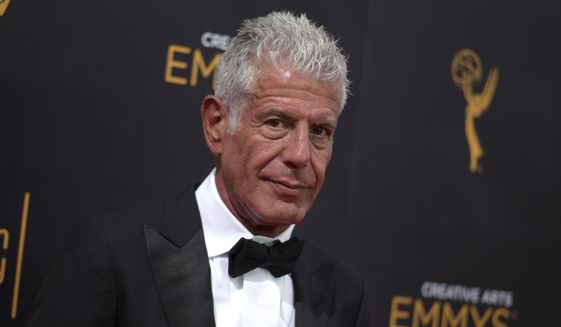 In this Sept. 11, 2016, file photo, Anthony Bourdain arrives at night two of the Creative Arts Emmy Awards in Los Angeles. Bourdain, who took his life in June, received several posthumous Emmy nominations on Thursday. (Photo by Richard Shotwell/Invision/AP, File)