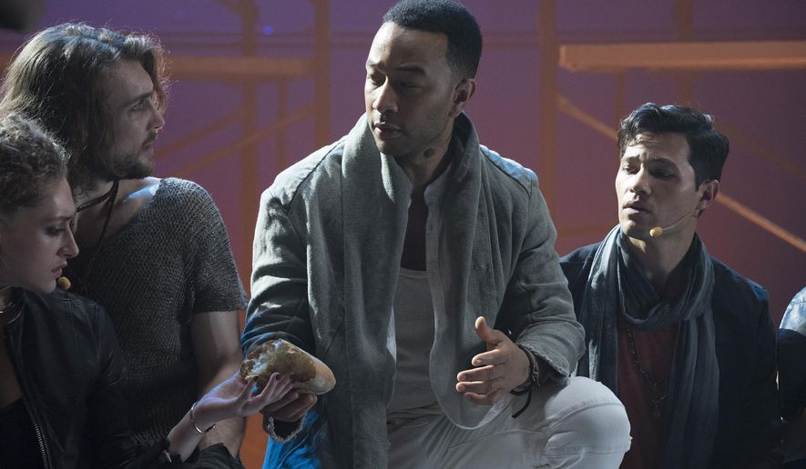 "This image released by NBC shows John Legend as Jesus Christ, center, from the NBC production, ""Jesus Christ Superstar Live In Concert."" Legend was nominated Thursday for an Emmy for outstanding lead actor in a limited series or movie. The 70th Emmy Awards will be held on Monday, Sept. 17.  (Virginia Sherwood/NBC via AP)"