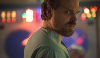 """This image released by Netflix shows David Harbour in a scene from """"Stranger Things 2."""" (Netflix via AP) **FILE**"""