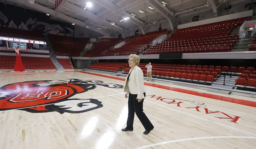 In this Sept. 7, 2016, photo, North Carolina State athletic director Debbie Yow walks on the court during a tour of the school's renovated Reynolds Coliseum, in Raleigh, N.C. North Carolina State has finally the top-25 national status that athletics director Debbie Yow sought to build throughout her eight-year tenure. Yet, in an interview with The Associated Press, Yow is balancing the joy from the best overall sports season in Wolfpack history with the fact the men's basketball program is entangled in a federal corruption investigation into the sport. (Ethan Hyman/The News & Observer via AP)