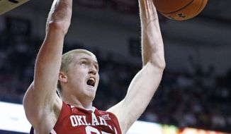 FILE - In this Feb. 13, 2018, file photo, Oklahoma's Brady Manek (35) dunks the ball during an NCAA college basketball game against Texas Tech, in Lubbock, Texas. Manek's strong freshman season got lost in Trae Young's dynamic freshman year. Manek, Oklahoma's No. 3 scorer last season, is preparing for his sophomore season and looks forward to taking on more of the load. (AP Photo/Brad Tollefson, File)