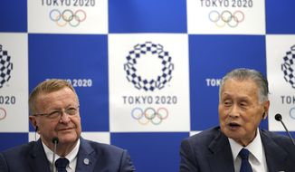 John Coates, left, chairman of the IOC Coordination Commission for the 2020 Tokyo Olympics and Paralympics and Tokyo Olympic organizing committee President Yoshiro Mori, right, attend the IOC and Tokyo 2020 joint press conference in Tokyo Thursday, July 12, 2018. (AP Photo/Eugene Hoshiko)