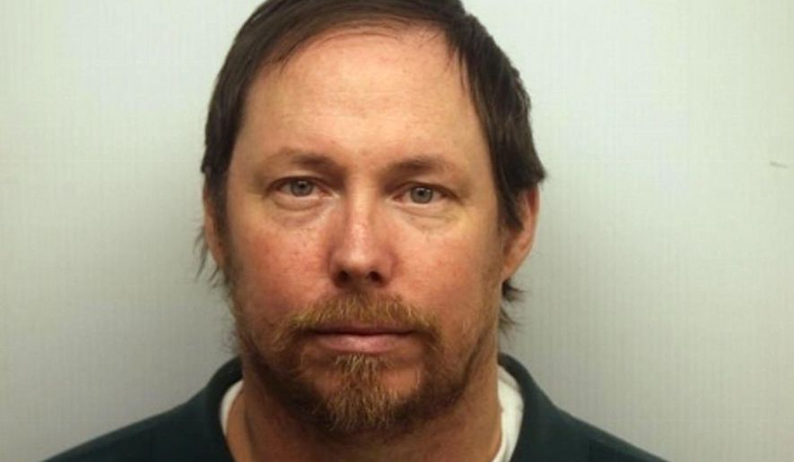FILE- This undated file photo provided by the Chatham County Sheriff's Office shows Kenneth Gardiner. After spending more than half their lives in prison for a crime their lawyers insist they had no part in, three former U.S. soldiers learned Thursday, July 12, 2018, that they are finally free from prosecution. Gardiner, Mark Jones and Dominic Lucci were released from prison in December, after the Georgia Supreme Court said in a unanimous ruling that prosecutors improperly withheld a police report that would have helped their defense.(Chatham County Sheriff's Office via AP, File)