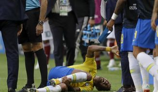 Brazil's Neymar lies on the ground during the round of 16 match between Brazil and Mexico at the 2018 soccer World Cup in the Samara Arena, in Samara, Russia, Monday, July 2, 2018. (AP Photo/Andre Penner)