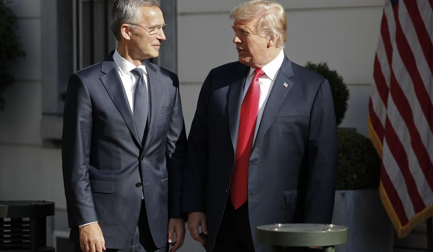 U.S. President Donald Trump, right, talks with NATO Secretary General Jens Stoltenberg, left, prior to their bilateral breakfast, Wednesday, July 11, 2018 in Brussels, Belgium. (AP Photo/Pablo Martinez Monsivais)