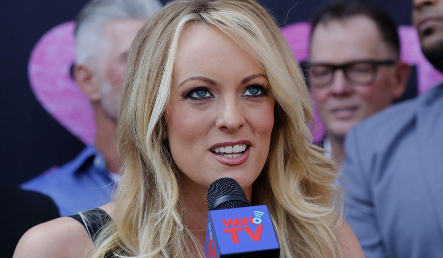 In this May 23, 2018, file photo, porn actress Stormy Daniels speaks during a ceremony for her receiving a City Proclamation and Key to the City in West Hollywood, Calif.  Daniels was arrested at an Ohio strip club and is accused of letting patrons touch her in violation of a state law, her attorney said early Thursday, July 12. (AP Photo/Ringo H.W. Chiu, File)