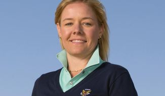 This June 20, 2015, photo provided by the USGA shows Sarah Hirshland during the third round of the 2015 U.S. Open golf tournament at Chambers Bay in University Place, Wash. The U.S. Olympic Committee has hired Sarah Hirshland as its CEO, placing the executive at the U.S. Golf Association in charge of stabilizing an organization that has been hammered by sex-abuse scandals spanning several Olympic sports. (Darren Carroll/USGA via AP)