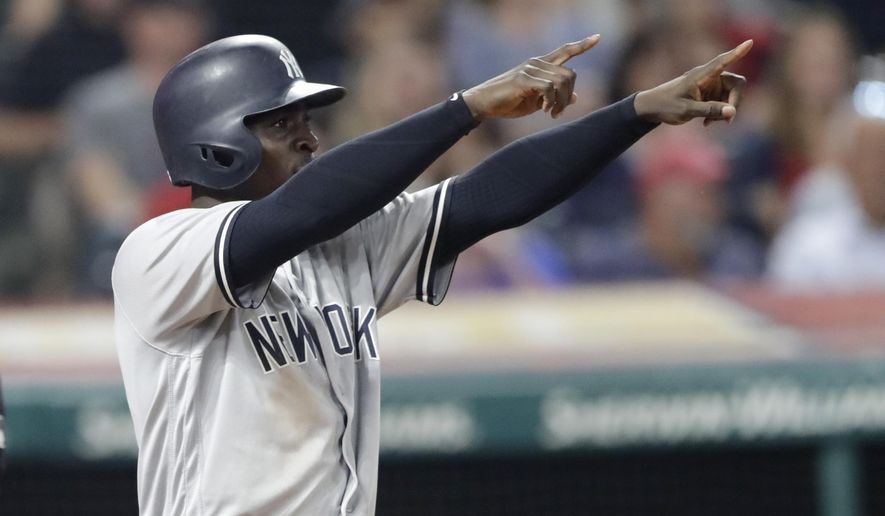 New York Yankees' Didi Gregorius looks toward Aaron Hicks at second base after Gregorius scored on a double by Hicks during the eighth inning of a baseball game against the Cleveland Indians, Thursday, July 12, 2018, in Cleveland. (AP Photo/Tony Dejak)