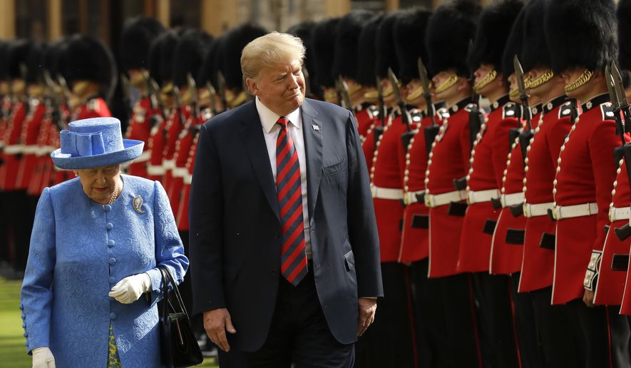 U.S. President Donald Trump and Britain's Queen Elizabeth II inspect a Guard of Honour, formed of the Coldstream Guards at Windsor Castle in Windsor, England, Friday, July 13, 2018.(AP Photo/Matt Dunham, Pool)
