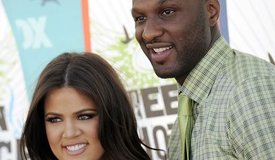 TV personality Khloe Kardashian and NBA star Lamar Odom wed after exactly one month of dating. (AP Photo/Chris Pizzello)