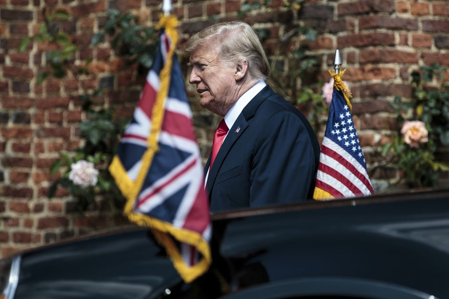 U.S President Donald Trump arrives to meet British Prime Minister Theresa May before their meeting at Chequers, in Buckinghamshire, England, Friday, July 13, 2018. (Jack Taylor/Pool Photo via AP)