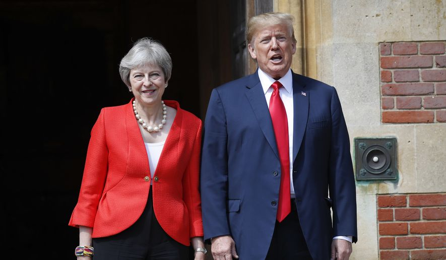 U.S. President Donald Trump, right, stands with British Prime Minister Theresa May, left, at Chequers, in Buckinghamshire, England, Friday, July 13, 2018. (AP Photo/Pablo Martinez Monsivais)