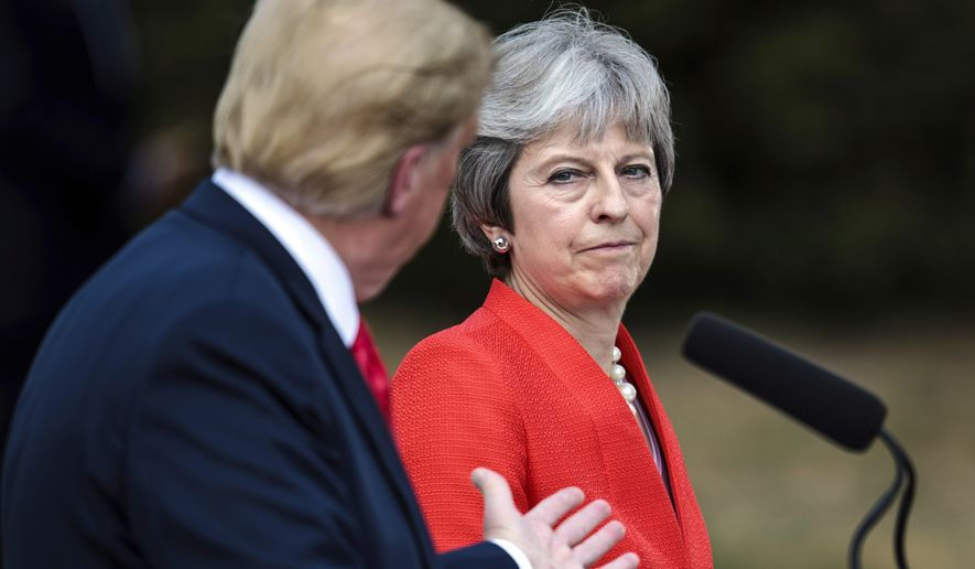 Britain's Prime Minister Theresa May and U.S. President Donald Trump answer questions during a joint press conference following their meeting at Chequers, in Buckinghamshire, England, Friday, July 13, 2018. (Jack Taylor/Pool Photo via AP)