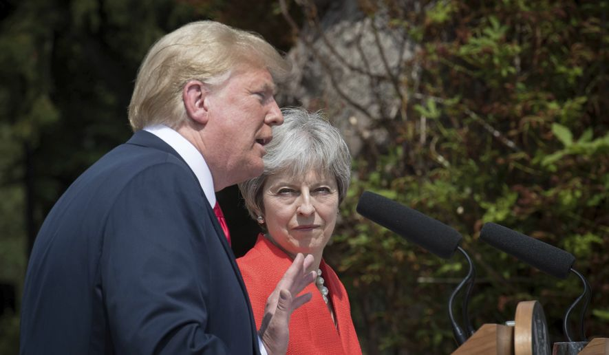 British Prime Minister Theresa May and U.S President Donald Trump hold a joint press conference at Chequers, in Buckinghamshire, England, Friday, July 13, 2018. (Stefan Rousseau/Pool Photo via AP)