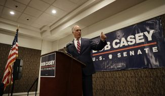 Sen. Bob Casey, D-Pa., gestures after being introduced before a general election campaign event with Sen. Kamala Harris, D-Calif., Friday, July 13, 2018, in Philadelphia. Harris is headlining a pair of fundraisers for Casey. (AP Photo/Matt Slocum)