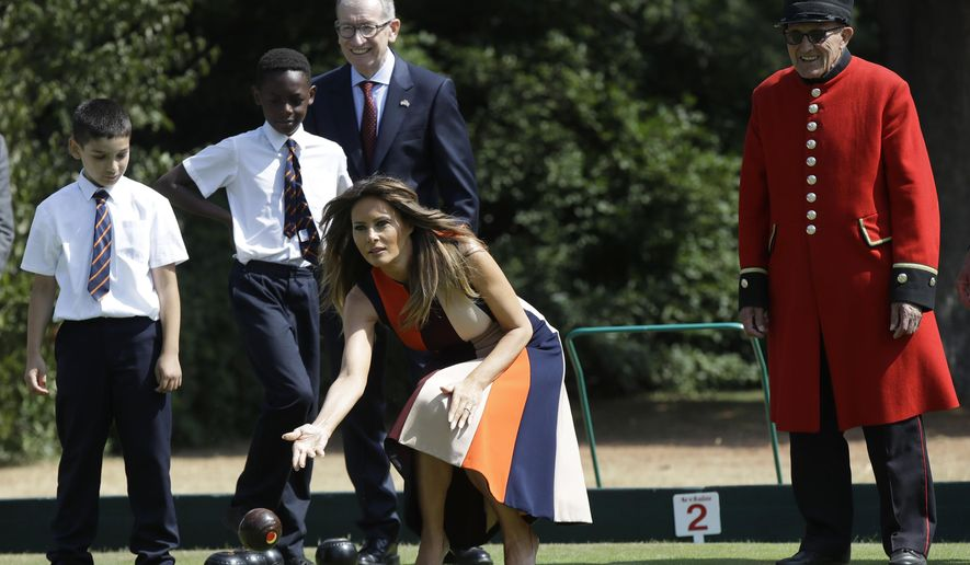 "U.S. first lady Melania Trump plays bowls she meets British military veterans known as ""Chelsea Pensioners"" at The Royal Hospital Chelsea in central London Friday, July 13, 2018. The pensioners, known for their scarlet coats and tricorne hats are a cherished British institution and are often seen parades, state events and other grand occasions. Smiling in rear is Philip May, the husband of British Prime Minister Theresa May. (AP Photo/Luca Bruno, Pool)"
