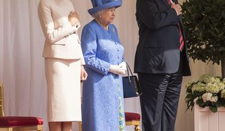 Britain's Queen Elizabeth II, centre stands with US President Donald Trump and first lady Melania on the dias in the Quadrangle as they listen to the US national anthem, during a ceremonial welcome at Windsor Castle, Friday, July 13, 2018 in Windsor, England. The monarch welcomed the American president in the courtyard of the royal castle. (Richard Pohle/Pool Photo via AP)