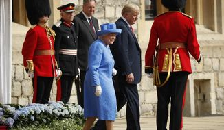Queen Elizabeth II and President Donald Trump walk together to inspect the Guard of Honour at Windsor Castle in Windsor, England. (AP Photo/Pablo Martinez Monsivais)