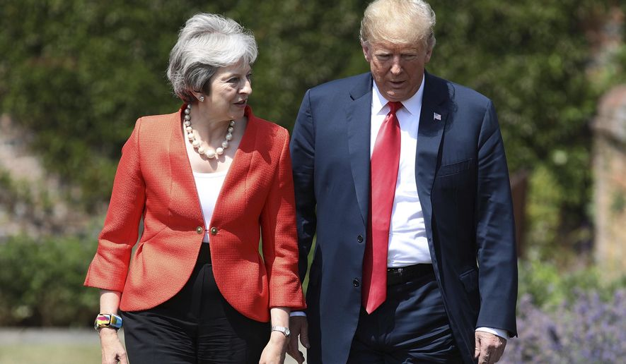 British Prime Minister Theresa May walks with U.S President Donald Trump prior to a joint press conference at Chequers, in Buckinghamshire, England, Friday, July 13, 2018. (Jack Taylor/Pool Photo via AP)