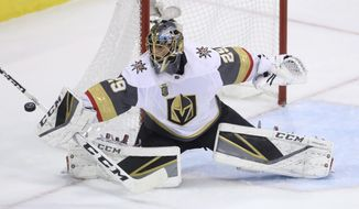 FILE - In this May 20, 2018, file photo, Vegas Golden Knights goaltender Marc-Andre Fleury (29) deflects the puck wide of the net during the first period of an NHL game against the  Winnipeg Jets, during the Western Conference Finals in Winnipeg, Manitoba. The Vegas Golden Knights have agreed to terms with three-time Stanley Cup champion goalie Marc-Andre Fleury on a three-year contract extension worth an average annual value of $7 million. The extension announced Friday, July 13, 2018, would keep him with Vegas through the 2021-22 season, creating the possibility that the 33-year-old Fleury could end his career with the Golden Knights. (Trevor Hagan/The Canadian Press via AP, File)