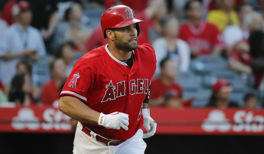 543bd80ff0 Los Angeles Angels' Albert Pujols watches his two-run home run during the  first inning against the Seattle Mariner during a baseball game Thursday,  July 12, ...