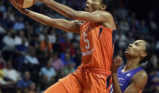 Connecticut Sun guard Jasmine Thomas blows by Phoenix Mercury defender DeWanna Bonner during the first half of a WNBA basketball game Friday, July 13, 2018, in Uncasville, Conn. (Sean D. Elliot/The Day via AP)