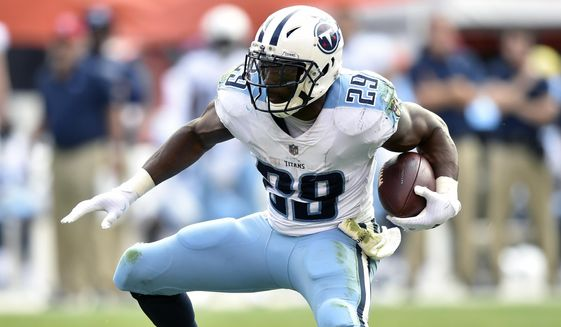 FILE - In this Oct. 22, 2017, file photo, Tennessee Titans running back DeMarco Murray (29) runs with the ball during an NFL football game against the Cleveland Browns, in Cleveland.  DeMarco Murray is retiring from the NFL. The 2014 Offensive Player of the Year made the announcement on ESPN on Friday, July 13, 2018, four months after being released by the Titans. (AP Photo/David Richard, File)