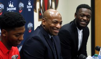 New Orleans Pelicans general manager Dell Demps, center, speaks at a news conference announcing the recent signings of Elfrid Payton, left, and Julius Randle, at their NBA basketball training facility in Metairie, La., Friday, July 13, 2018. (AP Photo/Gerald Herbert)