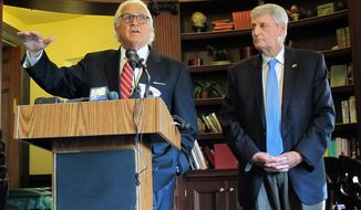 Maryland Senate President Thomas V. Mike Miller, left, and House Speaker Michael Busch discuss an FBI briefing they received about Russian links to a company that maintains part of the state election board's voter registration platform during a news conference in Annapolis, Md. on Friday, July 13, 2018.  (AP Photo/Brian Witte)