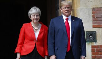 U.S. President Donald Trump and British Prime Minister Theresa May pose for photographers at Chequers, in Buckinghamshire, England, on July 13, 2018. (AP Photo/Pablo Martinez Monsivais) **FILE**