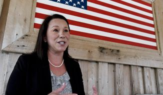 U.S. Rep. Martha Roby, of Alabama, campaigns at a fish fry in Andalusia, Ala. Roby drew a backlash for criticizing Donald Trump two years ago. Now shes trying to fend off primary challenger Bobby Bright with Trumps help, in the July 17 runoff. Bright represented the district for two years as a Democrat, but is running as a Republican and charges Roby with not being sufficiently conservative. (Mickey Welsh/The Montgomery Advertiser via AP, File)