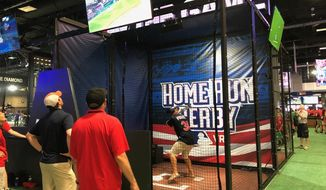 A baseball fan takes part in a virtual reality Home Run Derby during MLB All-Star FanFest at Walter E. Washington Convention Center in Washington, D.C., on Saturday, July 14, 2018. (Photo by Andy Kostka / The Washington Times)