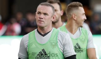 D.C. United forward Wayne Rooney, left, walks on the field before an MLS soccer match against the Vancouver Whitecaps at Audi Field, Saturday, July 14, 2018, in Washington. (AP Photo/Alex Brandon) ** FILE **