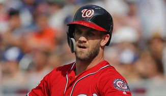 Washington Nationals' Bryce Harper pulls off his batting gloves after striking out to end the top of the first inning of a baseball game against the New York Mets, Saturday, July 14, 2018, in New York. The Mets won 7-4. (AP Photo/Julie Jacobson) **FILE**