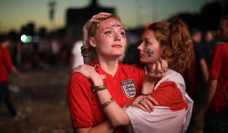England soccer fans react after England national soccer team lost the semifinal match between Croatia and England at the 2018 soccer World Cup, in Hyde Park, London, Wednesday, July 11, 2018. (AP Photo/Matt Dunham)