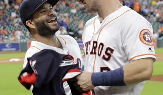 Houston Astros' Jose Altuve, left, jokes with Alex Bregman after they were presented their All-Star jerseys before a baseball game against the Oakland Athletics, Thursday, July 12, 2018, in Houston. (AP Photo/David J. Phillip)