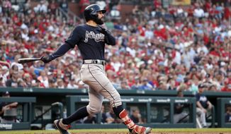 FILE - In this June 30, 2018, file photo, Atlanta Braves' Nick Markakis follows through on a grand slam during the fifth inning of the team's baseball game against the St. Louis Cardinals in St. Louis. Markakis kept saying he would rather have a four-day break with his family than be named an All-Star. Actually receiving his first All-Star selection changed all that. (AP Photo/Jeff Roberson, File)