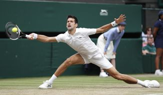 Novak Djokovic of Serbia returns a ball to Rafael Nadal of Spain during the men's singles semifinal match at the Wimbledon Tennis Championships, in London, Saturday July 14, 2018. (Nic Bothma, Pool via AP)